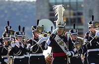 The West Point Band in marching formation led by the West Point Band drum-major.