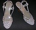 White Fioni high-heeled sandals with dark background.jpg