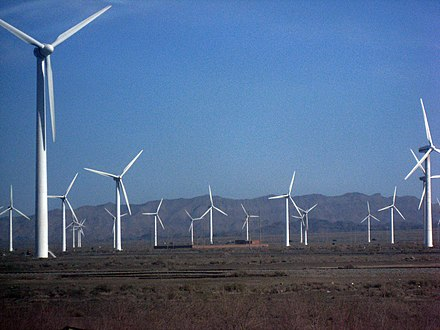 China has become a leader in wind power and solar panels. Wind farm xinjiang.jpg