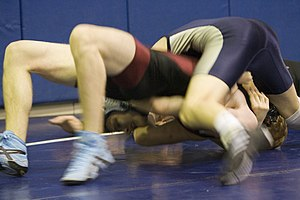 Bridge (grappling) - Wrestler on the bottom attempts to bridge out of a pin move