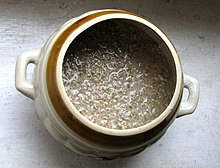 A ceramic pot filled with rye meal mixed with water