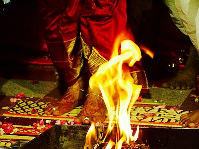 A wedding is the most extensive personal ritual an adult Hindu undertakes in his or her life. A typical Hindu wedding is solemnized before Vedic fire ritual (shown). (A) Hindu wedding, Saptapadi ritual before Agni Yajna.jpg