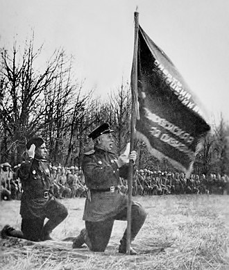 75th Guards Rifle Division - Officers and men of the division taking the Guards oath on 1 March 1943. Major General Vasily Gorishny is shown holding the flag, with Colonel Ilya Vlasenko to his left.
