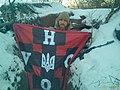 Юрій Луговський на фронті з прапором УНСО. 2016 р.jpg