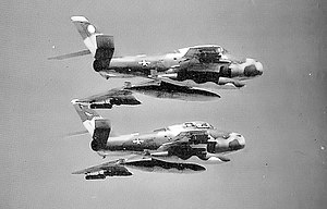 113th Air Support Operations Squadron - Two 113th Tactical Fighter Squadron F-84F Thundersteaks in Vietnam-era Camouflage livery flying in formation in 1966