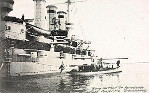 SMS Braunschweig - Braunschweig with King Haakon VII's boat alongside
