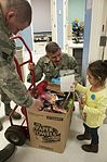 163d MXS delivers holiday cheer 121214-F-UF872-023.jpg