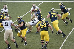 David Molk - Molk (50) lines up a block during 2009 Michigan – Notre Dame game.