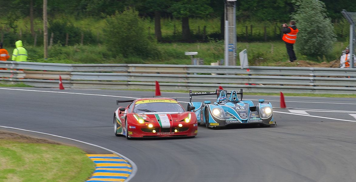 Morgan LMP2 #43 (right) of Morand Racing overtaking the AF Corse Ferrari 458 Italia #61 (left) during the 2013 24 Hours of Le Mans race.