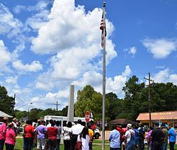 Kentwood residents observe a noontide Day of Prayer in front of the Town Hall in 2015