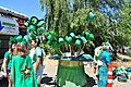 2015 Fremont Solstice parade - green hats for donations 01 (18689973323).jpg