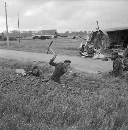 Commandos of 1st Special Service Brigade digging in near Horsa gliders on 6th Airborne's lodgement zone east of the River Orne, 7 June 1944. 6thbritairbornenormandytrench.jpg