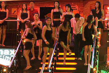 English: Prostitutes in front of a gogo bar in...