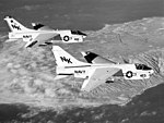 A-7E Corsair IIs of VA-27 in flight over the southern California coast on 1 October 1979 (6408645).jpeg