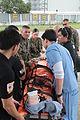 AFP, US service members evacuate injured people in wake of Haiyan 131118-M-UU132-384.jpg