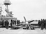 A Supermarine Seafire being brought up onto the flight deck of HMS FURIOUS, August 1944. A25076.jpg