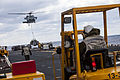 A U.S. Navy MH-60S Knighthawk helicopter delivers cargo to the amphibious assault ship USS Kearsarge (LHD 3) during a replenishment at sea in the Atlantic Ocean March 14, 2013 130314-M-SO289-023.jpg