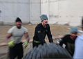 A U.S. Soldier with the 850th Transportation Company, Mississippi Army National Guard participates in the tire flip event during the National Guard 5-kilometer race and Minuteman Challenge at Bagram Airfield 131214-A-CJ112-141.jpg