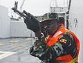 A Ugandan service member provides security aboard a target vessel during exercise Cutlass Express 2013 in the Gulf of Tadjoura off the coast of Djibouti Nov. 14, 2013 131114-F-NJ596-159.jpg
