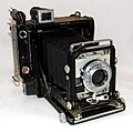 A Well-Used & Patched-Up Vintage Century Graphic Camera by Graflex, Introduced In 1949, Measures Approximately 5.75 Inches Wide, 6.75 Inches High & 3.25 Inches Deep, Made In USA (9108889904).jpg