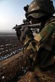 A commando from the Afghan National Army, 5th Commando Kandak, watches for suspicious activity during a shura in Pul-e Khumri district, Baghlan province, Afghanistan, Feb 120210-A-BT925-002.jpg