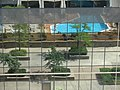 A total reflection of our swimming pool in the building across the street. (4827827833).jpg