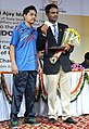"""A young sports person of """"Come & Play Scheme"""" of Sports Authority of India, after presenting the cheque of Special Cash Award to Shri Vijay Kumar, the Medal winner of London Olympics 2012, at the felicitation function.jpg"""