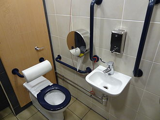 Accessible toilet - An accessible toilet at a restaurant with the alarm cord tied within reach