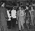 Adnan Kapau Gani arm in arm with Titien Sumarni, Film Varia 2.6 (Jun 1955), p38.jpg