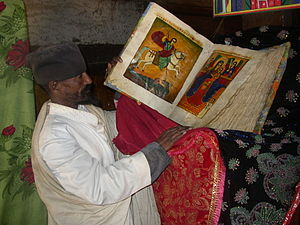 Orthodox Tewahedo biblical canon - Ethiopian Orthodox monk from Debre Damo Monastery with an illuminated Bible