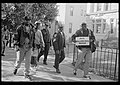 African American men walking on a sidewalk, probably on Capitol Hill, during the Million Man March in Washington, D.C..jpg