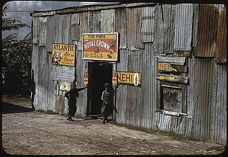 Belle Glade, Florida - African American migratory workers by a juke joint in Belle Glade, 1941.  Photo by Marion Post Wolcott.