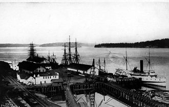 Alaskan (sidewheeler) - Alaskan at dock of Northern Pacific Railway at Tacoma, W.T. circa 1880
