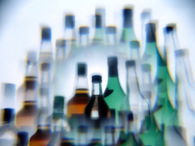 File:Alcohol bottles photographed while drunk.jpg
