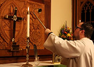 Acolyte - An Episcopal acolyte lighting an altar candle