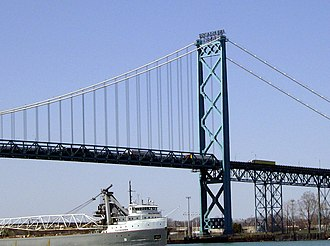Ambassador Bridge - A lake freighter sailing under the bridge on the Detroit River