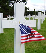 American Flag and Cross in Normandy American Cemetery and Memorial