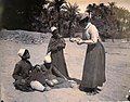 Amy, Flinders Petrie's sister-in-law, buying antiquities at Abydos, c. 1899.jpg
