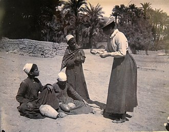 Abydos, Egypt - Amy, Flinders Petrie's sister-in-law, buying antiquities at Abydos, c. 1899