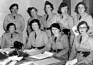 Bell seated at a council meeting of the Women's Air Training Corps