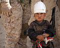 An Afghan child stands with U.S. Marines from 2D Battalion, 11th Marines, Echo Battery at the district center in Delaram, Nimroz province, Afghanistan March 14, 2012 120314-M-BE386-119.jpg