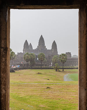 """Frame of the Angkor Wat  (""""Capital Temple"""") in a rainy day, former capital of the  Khmer empire, today Angkor, Cambodia. Angkor Wat, built by the Khmer King Suryavarman II in the early 12th century, is a temple complex and largest religious monument in the world. Originally founded as a Hindu temple for the Khmer Empire, gradually transforming into a Buddhist temple toward the end of the 12th century."""