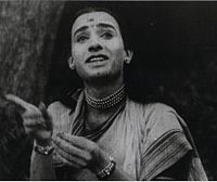 A black-and-white picture of a man posing as woman
