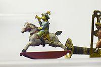 Antique toy bugle boy on horseback (25594316873).jpg