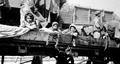 Armenian children of Adana on the deportation train.png