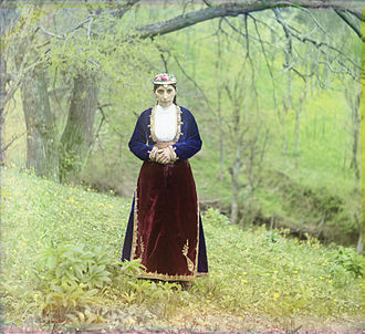 Artvin - An Armenian woman in national costume poses on a hillside near Artvin (in present-day Turkey), circa 1910.