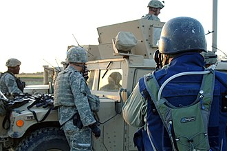 Embedded journalism - An embedded civilian journalist taking photographs of US soldiers in Pana.