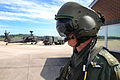 Army Air Corps Pilot Walks to his Apache Helicopter MOD 45152779.jpg