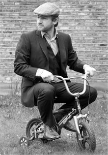 Author Illustrator Simon Basher on a tricycle.jpg
