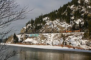 Railway slide fence - A BNSF oil train is eastbound in Bad Rock Canyon where railway slide fences are installed.